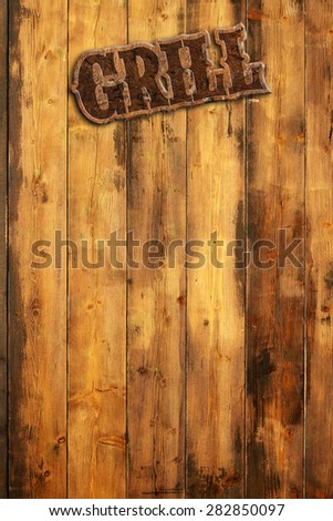 """plaque """"grill"""" hanging by a wooden wall - stock photo"""