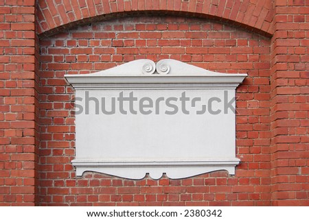 plaque on a brick wall - stock photo