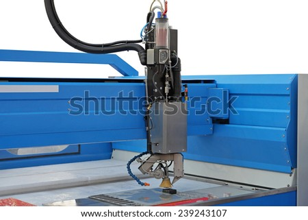 Plasma cutter CNC machine in workshop - stock photo