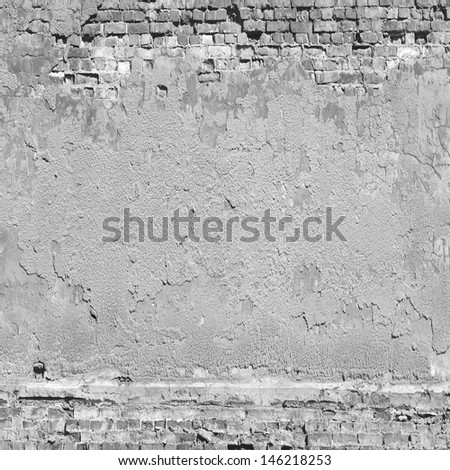 plaster and brick wall texture background in black and white - stock photo