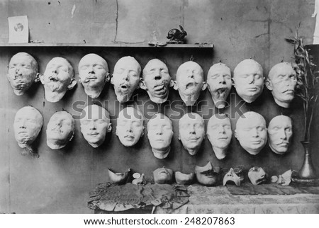 Plaster casts of WW1 soldiers' mutilated faces in sculptor Anna Ladd studio. 1918. Below them are plaster molds of 'restored' faces Ladd modeled. France, 1918. - stock photo