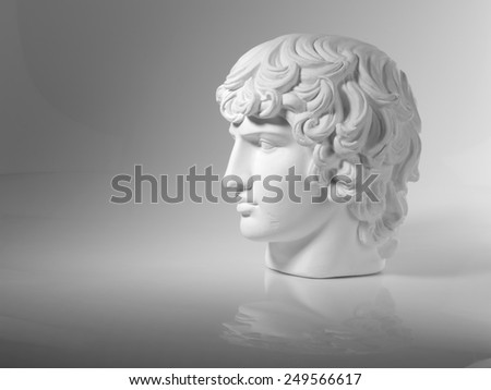 Plaster head on a gray background - stock photo