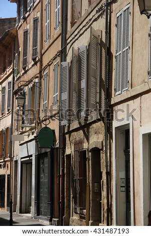 Plastered facades in traditional Provencal colors in Aix-en-provence - stock photo