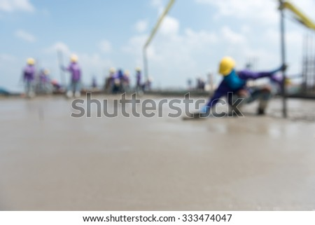 plasterer concrete cement work. using a trowel to smooth or leveling concrete slab floor work step of the building construction.  - stock photo