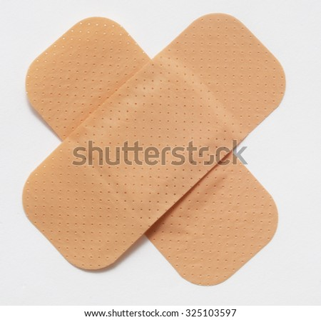 plasters isolated in plan - stock photo