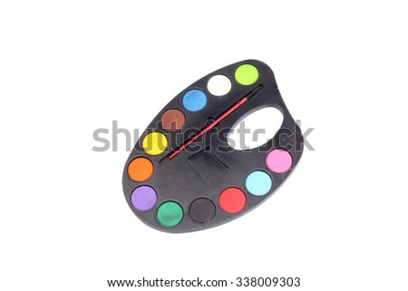 plastic art palette with paints and brushes, isolated on white background - stock photo