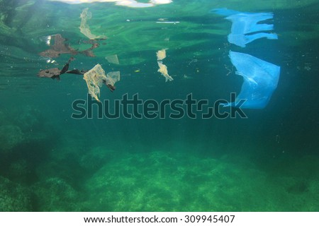 Plastic bag garbage trash rubbish pollution in ocean - stock photo