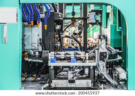 Plastic Bottle Blow Molding Machine in factory - stock photo