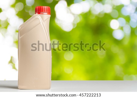 Plastic bottle from automobile oil - stock photo