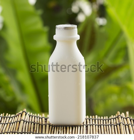 Plastic bottle of Fresh Milk on the table  - stock photo