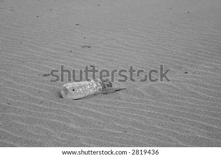 plastic bottle on the sand - stock photo