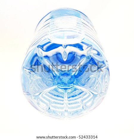 Plastic bottle with water laying down and being photographed from bottom to top. - stock photo
