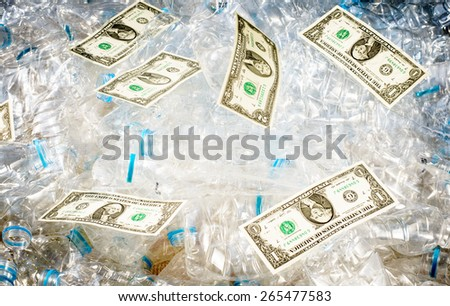 Plastic bottles garbage become to money also save the world ,a good business This picture is not flat currency scans or photographs but just put the money on the bottles and press the shutter release - stock photo