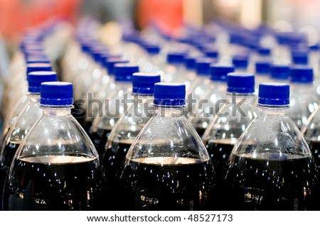 Plastic bottles in shop - stock photo