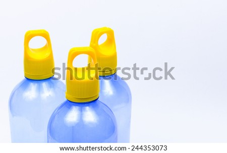 Plastic bottles of drinking water on white backgroud - stock photo