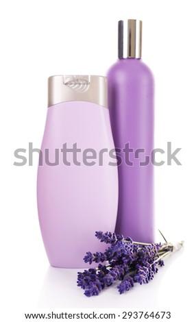 Plastic bottles of shampoo with fresh lavender isolated on white - stock photo