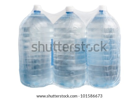 Plastic bottles with water packing in polyethylene film  for humanitarian and emergency help - stock photo