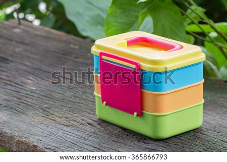 Plastic boxes for food on the old wooden floor.Plastic containers for food - stock photo