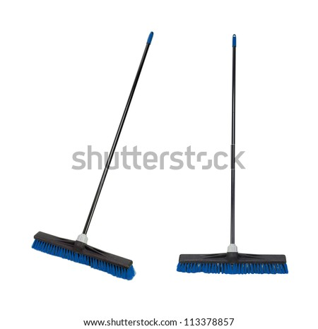 Plastic brooms isolated on white - stock photo