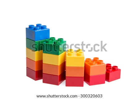 Plastic building blocks isolated on white background - stock photo
