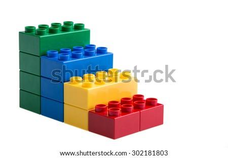 Plastic building blocks isolated on white background - stock photo