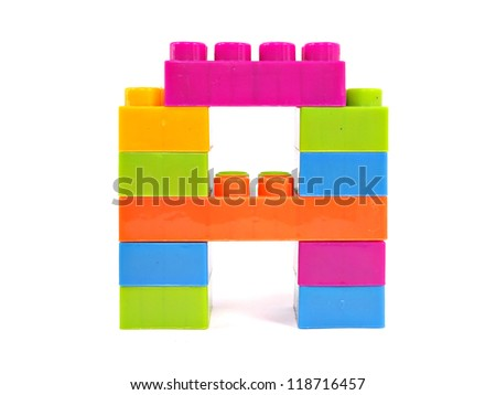 plastic building blocks letter A on a white background - stock photo