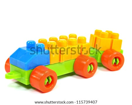 plastic building blocks truck on a white background - stock photo