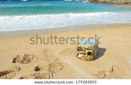 plastic canister by the shore - stock photo