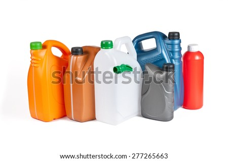 Plastic canisters for machine oil isolated on white background. - stock photo