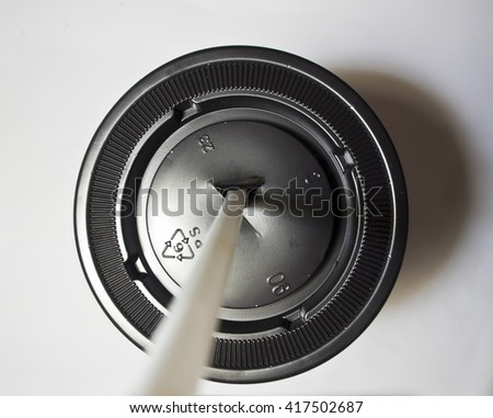 Plastic cap of cup and straw - stock photo