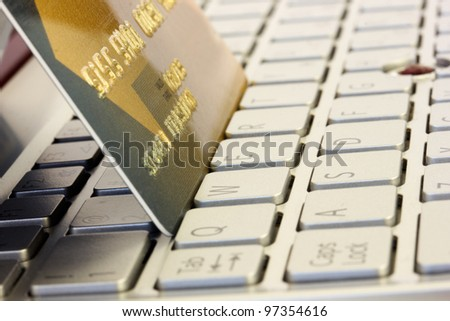 plastic card on computer keyboard - stock photo