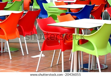 Plastic chairs and tables at fast food restaurant - stock photo