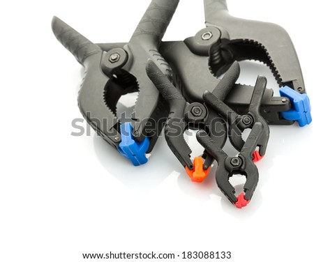Plastic clamps on white background - stock photo