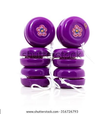 Plastic colored yo-yo isolated on white background - stock photo