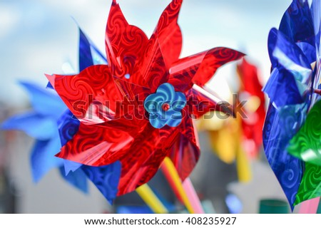 Plastic colorful pinwheels for kids - stock photo