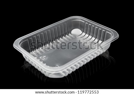 plastic container isolated on black - stock photo