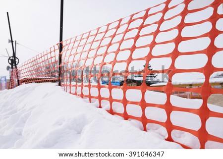plastic fence and snow, with bring eye - stock photo