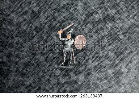Plastic figure toy of knight in fighting action model represent the medieval historical concept related idea. - stock photo