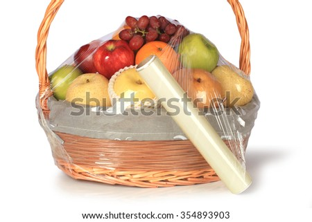 Plastic film preservation Apples packed in food film on table on white background. This has clipping path. - stock photo