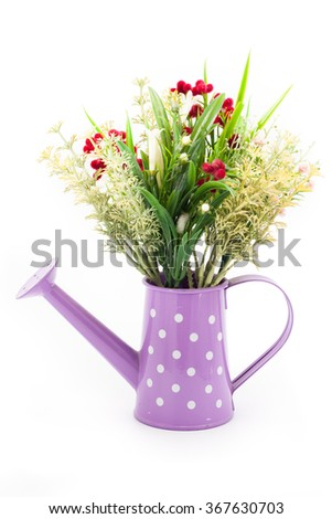 Plastic flower decorate in watering can isolated on white background - stock photo