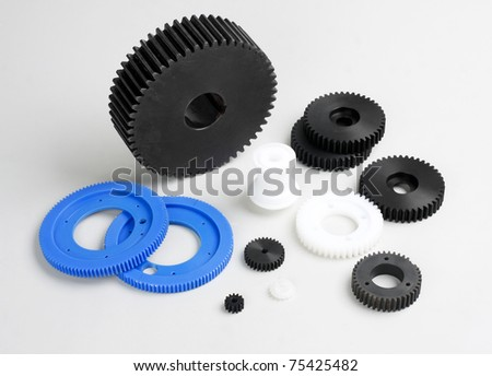 Plastic gears wheel the spare parts in the engine machine - stock photo