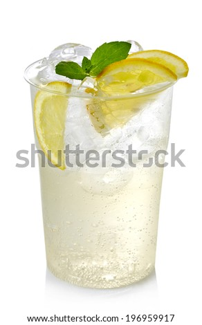 Plastic glass of lemon lemonade with ice and lemon slices isolated on white background - stock photo