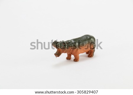 Plastic hippo toy on a white background - stock photo