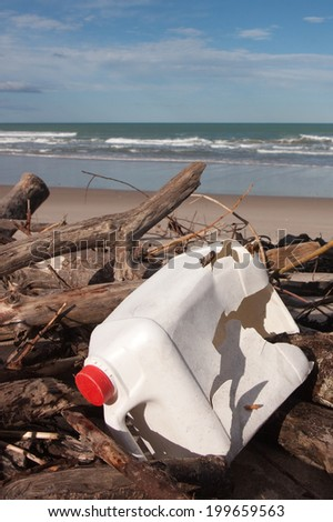 plastic oil canister washed up as rubbish on a beach  - stock photo