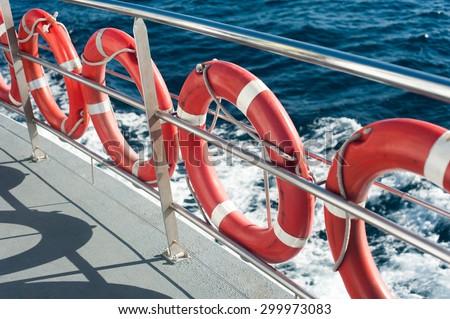 Plastic orange Lifebuoys are on the boat - stock photo