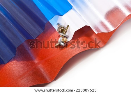Plastic roof polycarbonate in different shapes, colors and mounting screws - stock photo