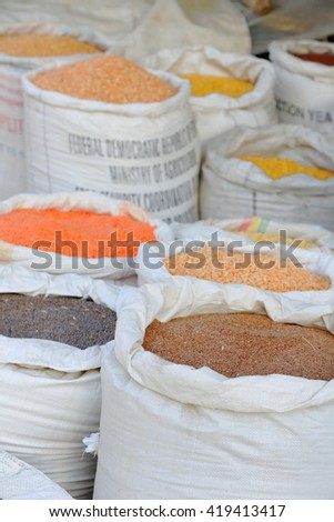 Plastic sacks with various kinds of legumes -lentils-soybeans- and cereals -corn-teff-  in the Adi Haki market of Mek'ele-Mekelle town at 2084 ms.high in Debubawi-Southern zone. Tigray region-Ethiopia - stock photo