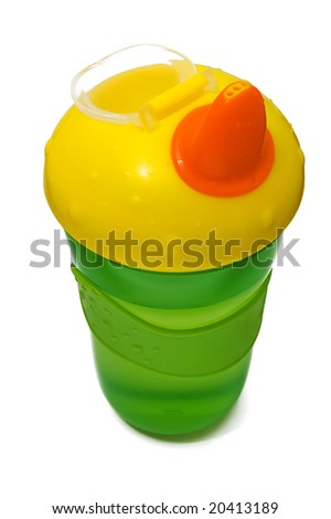 Plastic sippy cup, green with yellow cover, isolated on white background - stock photo