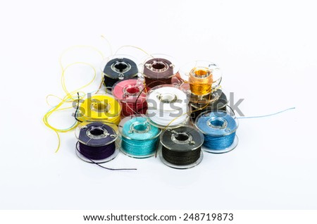 Plastic spools of threads. Colored bobbins for sewing machine. - stock photo