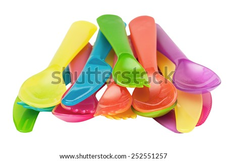 Plastic spoons, knives, forks violet, orange, yellow, blue, red isolated on the white - stock photo